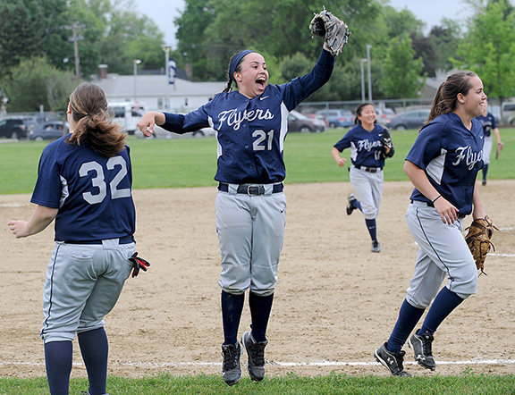 6/4/14-- FRAMINGHAM--  Framingham Capt. Marisa Sanchez celebrates after catching the final out in a 3-0 playoff victory over Boston Latin Wednesday.Daily News Staff Photo/Art Illman