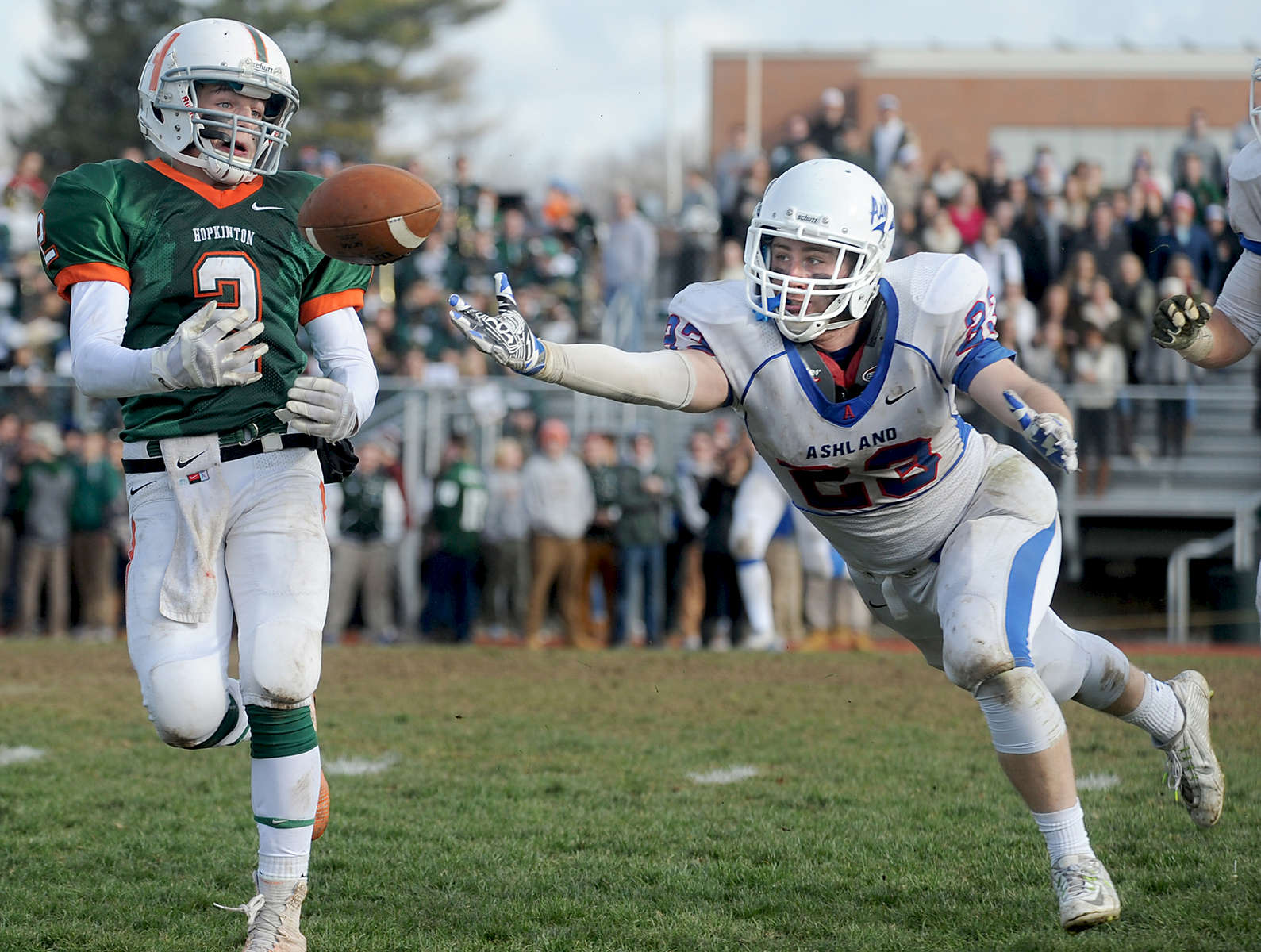 Hopkinton's #2 Will Abbott about to catch what would be the winning touchdown against Ashland in the fourth quarter at David M. Hughes Stadium on Thanksgiving. Defending is #23 Filip Cooper. The final score was 35-33.Daily News Staff Photo/Art Illman