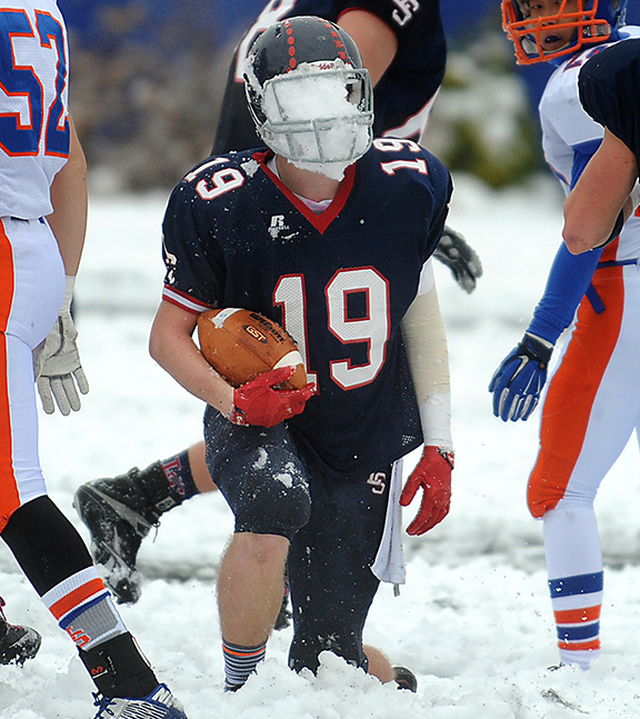 11/27/14 SUDBURY--- Lincoln Sudbury Regional High School running back #19 captain Eric Jones comes up with a facemask full of snow during the Thanksgiving game against Newton South Thursday morning.Daily News Staff Photo/Art Illman