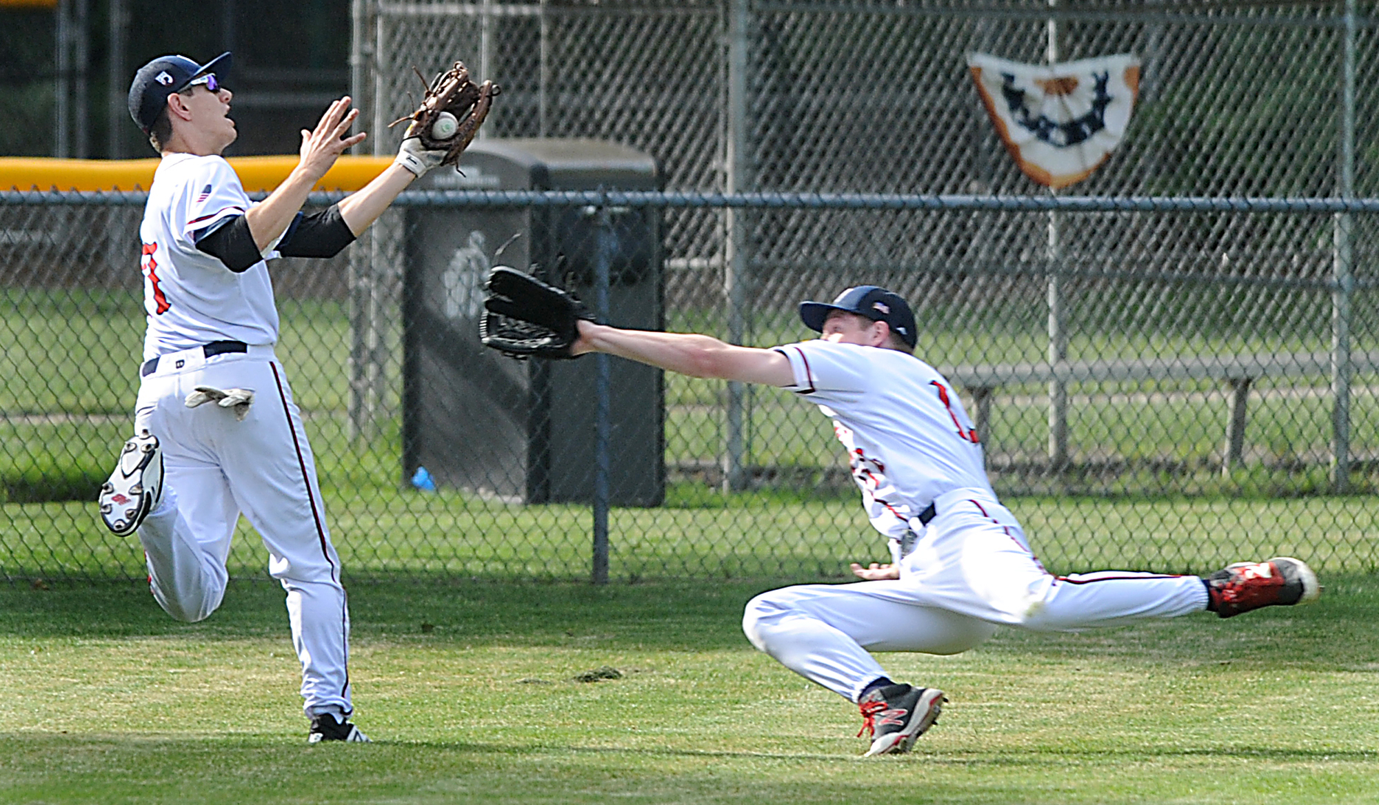 6/22/17-- NORTHBOROUGH-- Northborough Legion outfielder Max Morhardt makes a running diving catch with Collin Mitchell also in pursuit to end the first inning against Grafton Hill Thursday evening. [Daily News and Wicked Local Staff Photo/Art Illman]