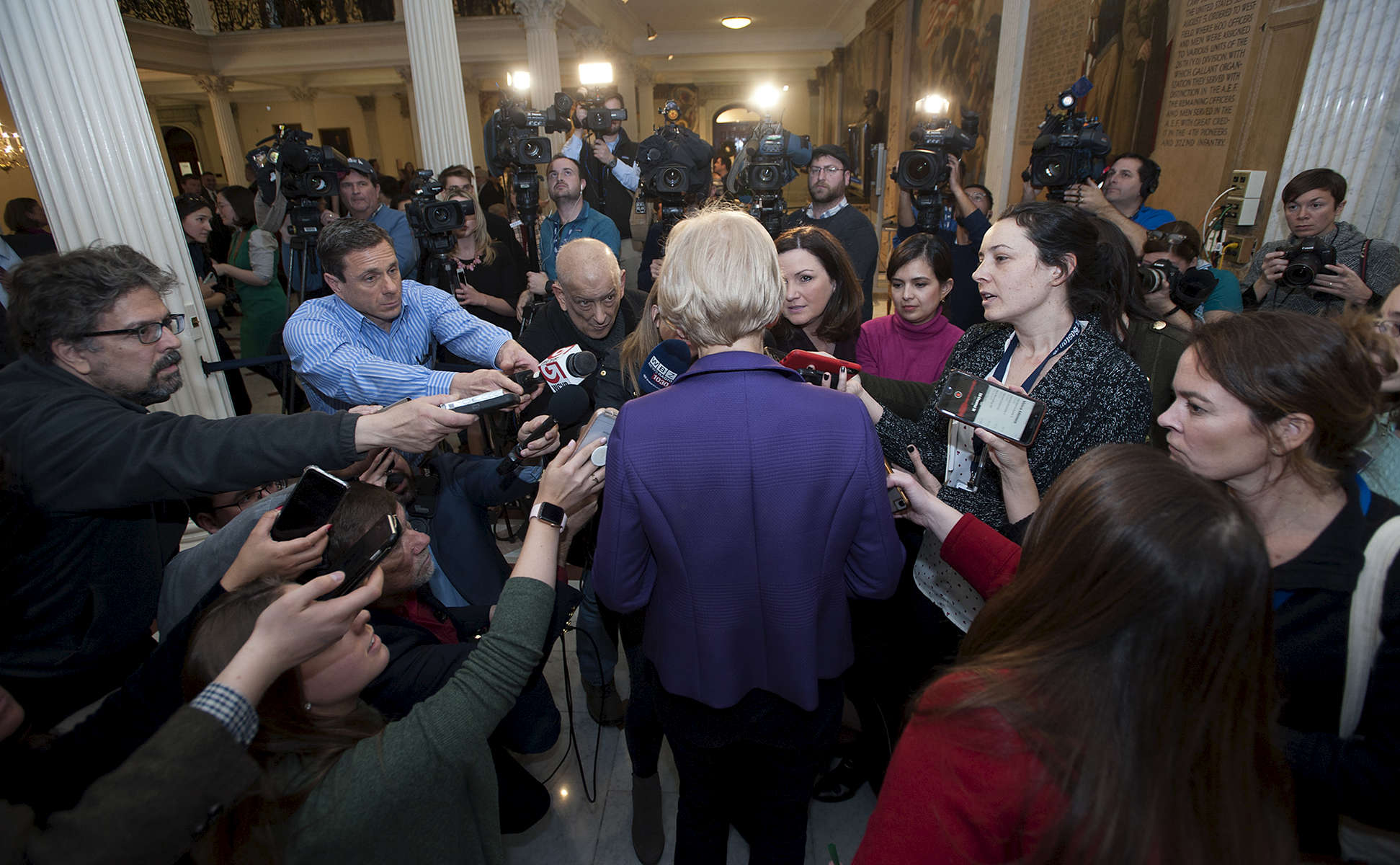 1/2/19-- BOSTON--  Senator Elizabeth Warren surrounded by the Boston media after legislators were sworn in at the Senate chambers Wednesday. She announced an exploratory committee to run for President. [Daily News and Wicked Local Staff Photo/Art Illman]