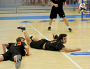 6/15/17 WORCESTER -- Wayland High School #15 captain Cam Gordon and #11 Asa Greenaway hit the floor during the first game against Westfield High School in the MIAA Div.1 Boys Volleyball State Final Thursday at Worcester State University.  [Daily News and Wicked Local Staff Photo/Art Illman]