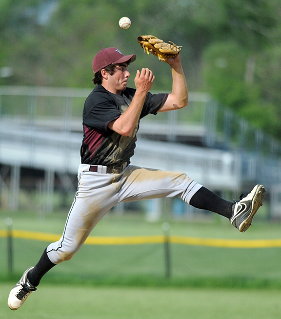Weston shortstop Steve Tocci goes airborne tring to snag a line drive in action Monday afternoon at Concord Carlisle.
