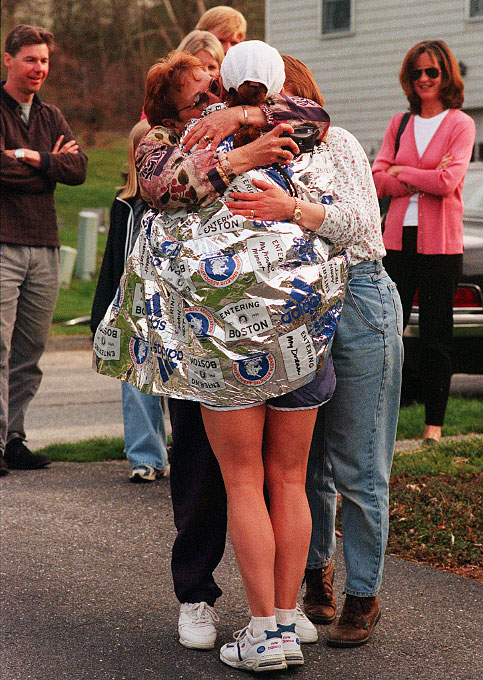 1999, in Westborough, a warm welcome for Ellen Riley as she returned home, receiving hugs from mom Claire Sonner, sister Robin Cronin. Looking on at left friend Dave Hatch, and right, friend Carol Hamilton.
