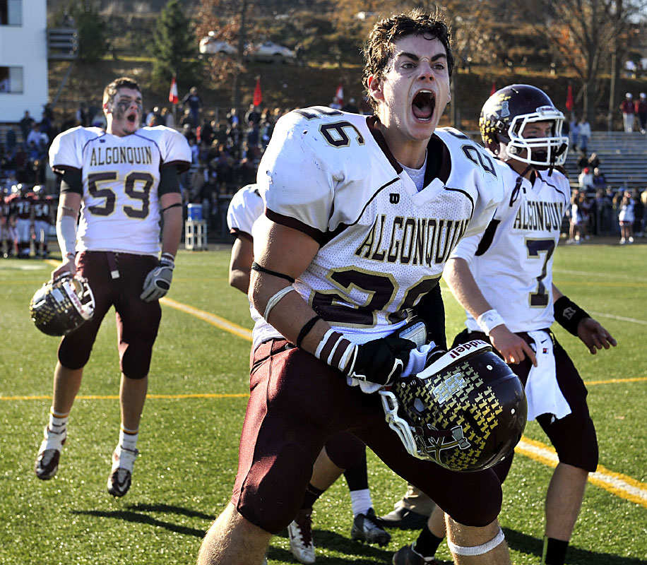 Algonquin's Danny Bishop, Zach Gittlen, left, and Mike Halloran, right, celebrate their Thanksgiving victory over Wesborough.