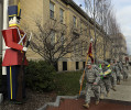 Army National Guard 1060th Transportation Company out of Framingham marched with toy filled backpacks down Concord Street to the Salvation Army headquarters Wednesday, delivering gifts for the Angel Tree Toy program. The toys will be distributed to families next week. Here they march past the Memorial Building and a Shoppers World Toy Soldier.