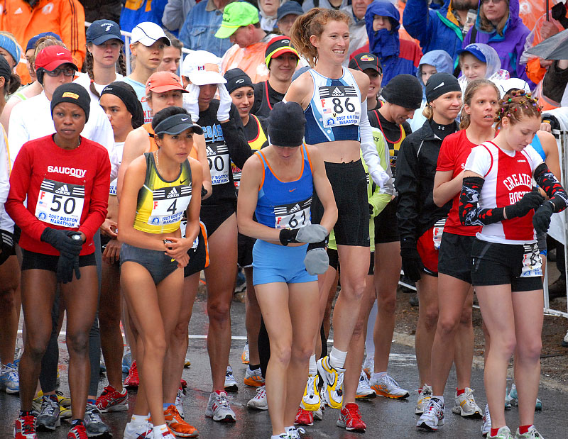 Lori Stich Zimmerman of  Texas gets a jump on the other elite women runners just prior to the Boston Marathon start in Hopkinton.©Art Illman photos 2011