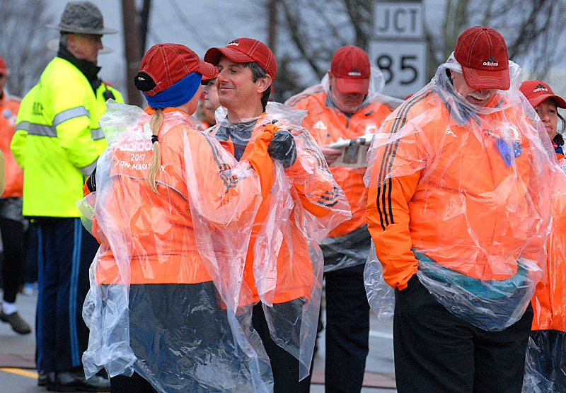 In 2007, Debra Joy and Alan St. Germaine,  of Haverhill, members of the Marathon starting line human chain, dance in the rain.
