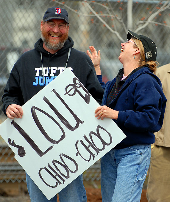 In 2006 along Waverly Street in Framingham,Fuller Middle School teacher Phil Reitz and wife Beth react after seeing  fellow Fuller teacher Lou {quote}Choo Choo{quote} Fazio run by.