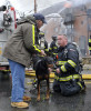 Marlborough Firefighter Tom Mellor returns April to owner Hal Babbits at the Lake Williams condo complex at 273 West Main St.  in April of 2012. Capt. Dave D'Amico, Lt. Dan Chiroussis, and firefighters Matt Lupisella  and Mellor went in to rescue the dog from the second floor during the six-alarm blaze.