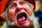 "Frank ""Freight Train"" Mills of Cobbtown, Ga. displays his enthusiasm at the start of the games July 10 at the Redneck Games in East Dublin, Ga. ""Where did my teeth go?"" Mills said. ""Brass knuckles."""