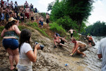 Patrons avoid getting hit on a makeshift mud slide into the Occone River July 10 at the Redneck Games in East Dublin.