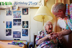Mary Ray, 114, shakes the hand of her son Donald, 84, both of Westmoreland during a visit Tuesday, Aug. 18 at Maplewood Nursing Home in Westmoreland. Mary is the third oldest living person in the world currently. She was born May 17, 1895 in New Brunswick, Canada during Grover Cleveland's U.S. presidency.