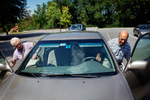 Eileen Motivala, left, and her husband, Noshir, both 74 of Nashua, enter their Toyota Camary Wednesday, Aug. 19 at the Senior Center in Nashua. Both just competed a two day AARP driving course.