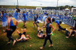 Athletes have their wetsuits ripped off by volunteers after their the 1.2 mile swim in the Savannah River Sept. 26 in Augusta, Ga. The annual ESI Ironman Augusta 70.3 miles was one of the best half Ironman turnouts in the nation. Over 3,000 participated.