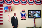 A life-size cutout of Republican presidential candidate Mitt Romney is seen juxtaposed with Fox News broadcasting poll predictions and President Obama on the screen Monday, Sept. 10, 2012 at the Mitt Romney Victory Office in Boca Raton. At the time of the broadcast it was predicting a 4 to 5 percent margin in favor of Obama.