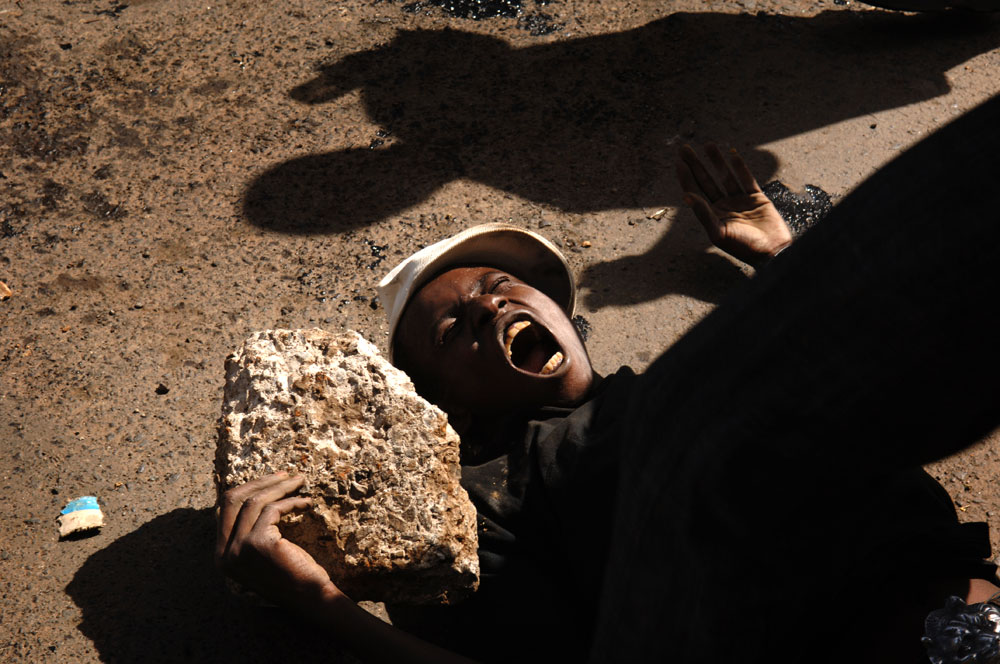 A supporter of Kenya's opposition leader Raila Odinga screams during a demonstration on the second day of attempts to disperse renewed protests, in the Kibera slums Nairobi, Kenya.
