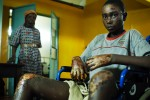 A burned boy sits in a wheelchair in the hospital after he was burned at Kenya Assemblies of God Church in Eldoret, western Kenya. At least 35 people were burnt to death in the church where they had taken shelter from tribal clashes sparked by disputed presidential elections.