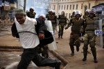 Riot police chase a man in down town Nairobi as supporters of Kenya's Opposition leader Raila Odinga took to the street causing down town Nairobi to  become a seen of clashes and mayhem.