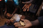 A Kenyan man and woman lay dead on the ground after they were shot by Kenyan police during clashes in the Kibera slums.