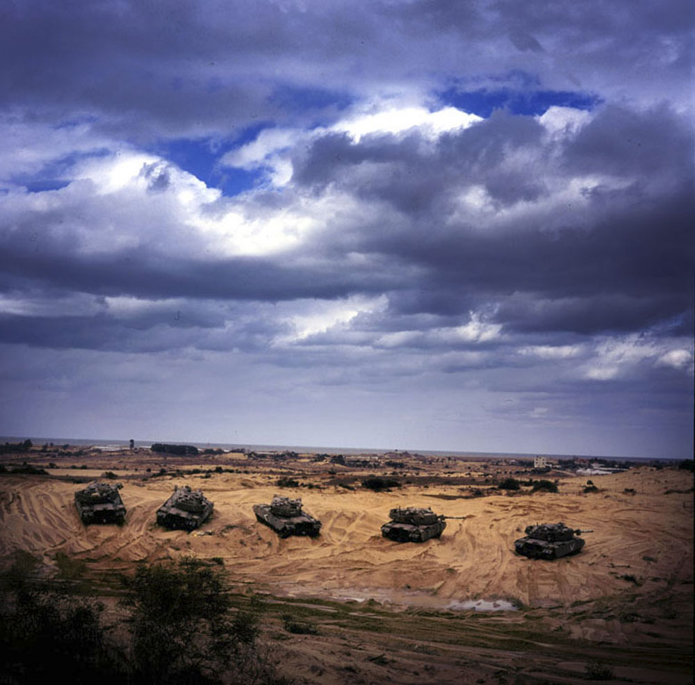 Israeli Army tanks sit deep in the sand dunes near the Kisofim route, the only road leading into the Gush Katif settlement block, Gaza.