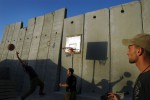 IDF solider play basketball behind a barricaded wall in side a military compound in Gush Katif settlement block, Gaza.