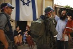 A right-wing Jewish settler argues with Israeli police preparing to evacuate him and his family from their house in Sanur settlement in the West Bank.