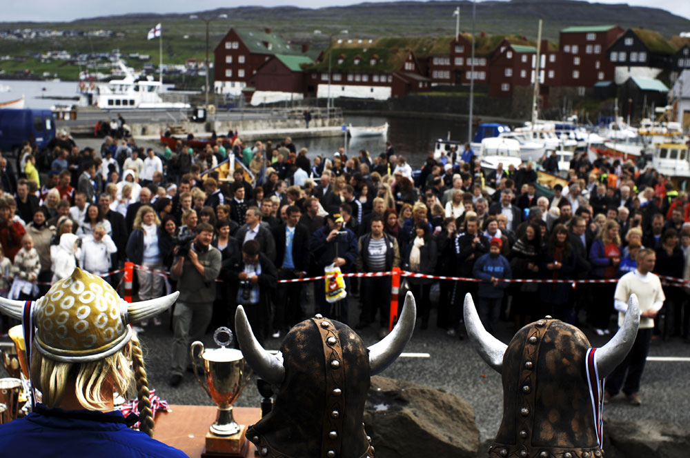Young men wear Viking horns as they receive medals after the rowing competitions during St. Olav's Day - The National Festival in Torshavn the capital of the Faore Islands.