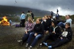 Teenage girls sit on the ground near a campfire in a religious summer school in the Faore Islands. Although being of Viking descents the Faroe Island has become a very religious Catholic country with 98% of the people belonging to the local church.