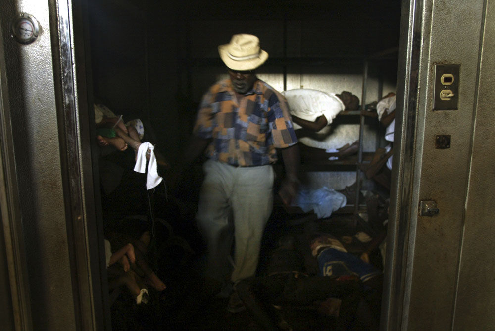 A man walks in the storage room of the morgue at the hospital in Gonaives after it has been closed ever since the rebels took control of town causing many deaths.