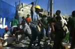 Mass looting takes place in the port of Porta au Prince as chaos spreads across the streets of the capital the day after president Aristide fled the countr.