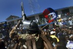 Rebels are surrounded by supporters as they take over the city of Port-au-Prince.