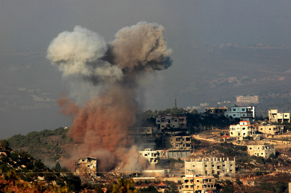 A plume of smoke billows in the Lebanese border village of Aita-al after an Israeli Air-Force attack.