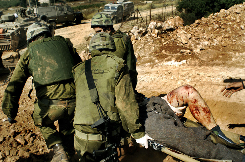 A wounded Israeli soldier is evacuated after he was injured during action against Hezbollah in south Lebanon .