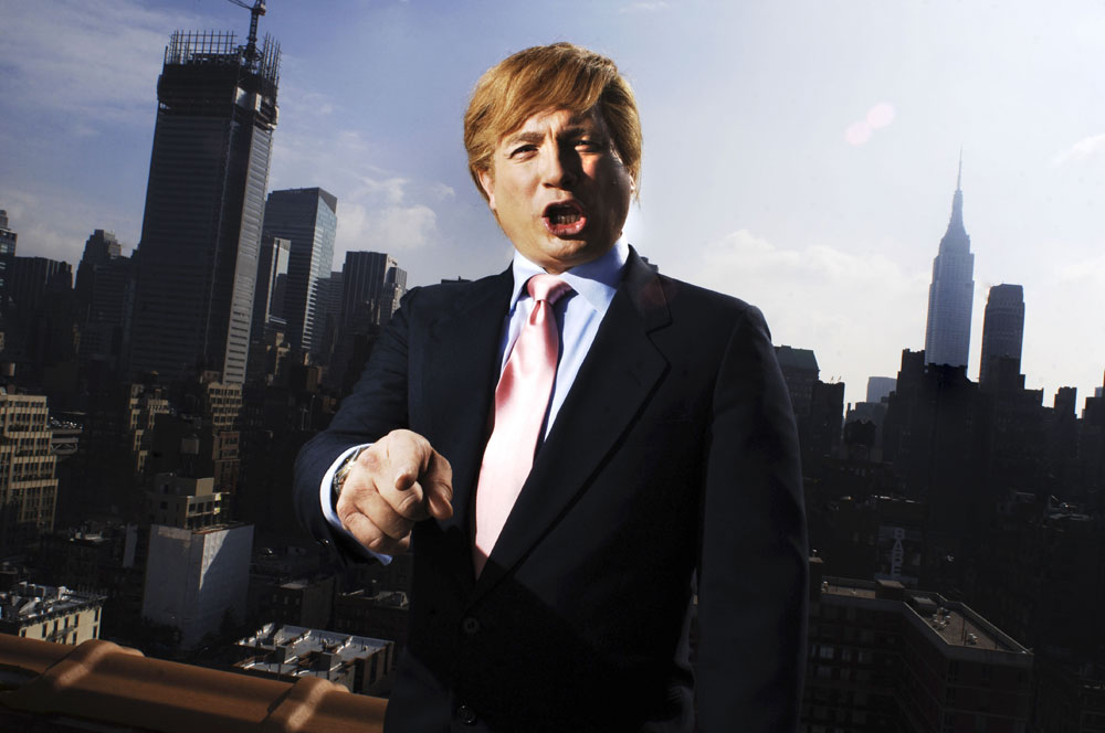 John Di Domenico gestures after he has transformed into one of 30 characters he impersonates, Donald Trump, on a Manhattan roof top. He has spent many hours with a vocal coach to perfect the voices of his characters and hundreds of dollars on authentic wigs, glasses, watches and other accessories.