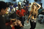 Kym Perfetto dances in a local barber shop as she impersonates the Latin pop star, Shakira in Willamsburg, Brooklyn. Kym works as a personal trainer and is an aspiring actress and singer residing in New York City. To make extra cash, Kym performs as Shakira, Brittney Spears, and Marilyn Monroe at corporate events and private parties.
