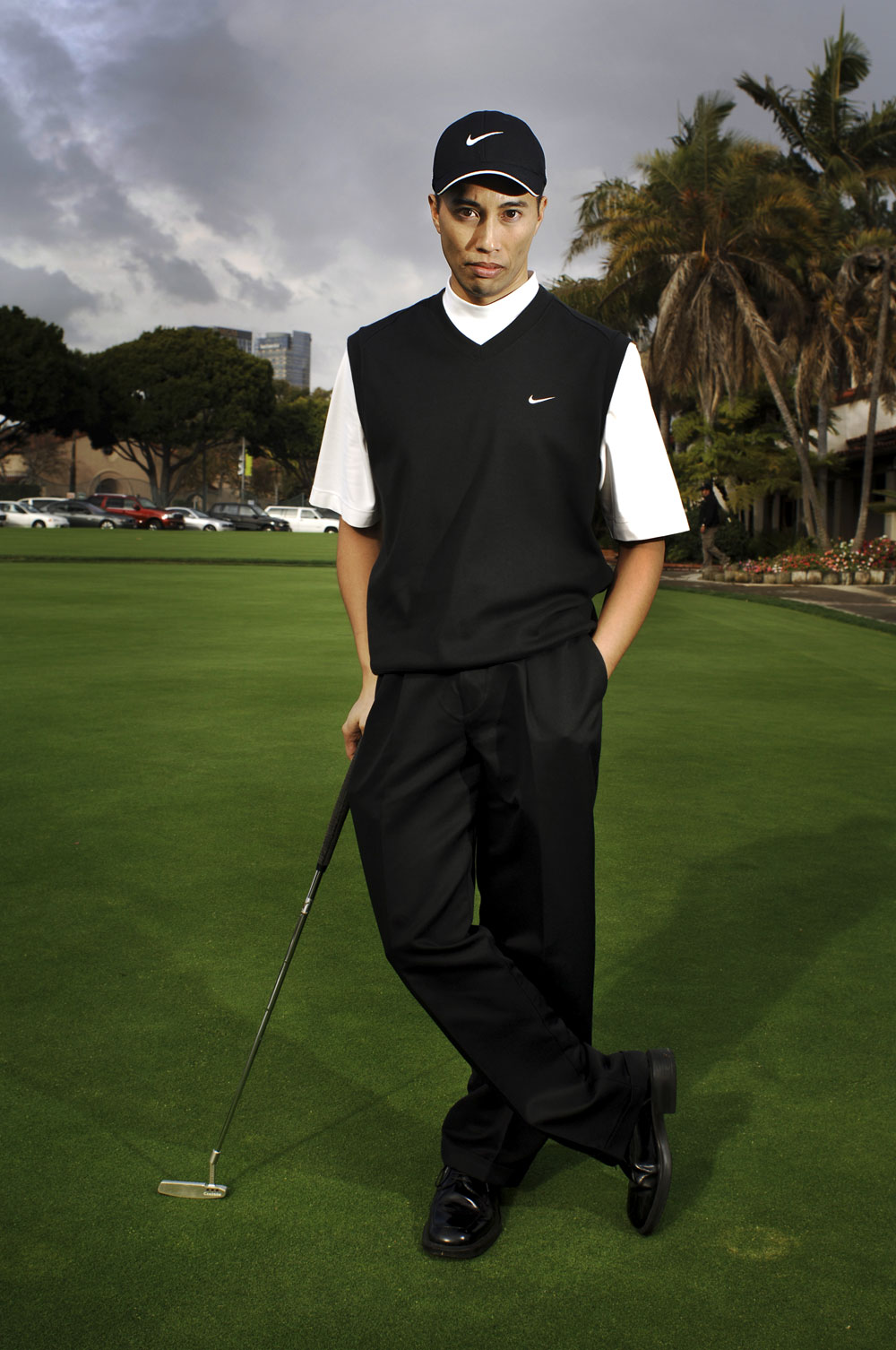 Herme Chua poses with his golf club impersonating the talented professional golfer, Tiger Woods in Beverly Hills, California. Chua has a full-time job working with computers, but offers his services as a Tiger Woods look-alike when he can.