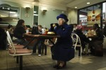 Patricia Ford, a Queen Elizabeth II impersonator, enjoys her lunch at McDonald's in London, England.