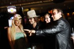 Paris Hilton, Johnny Deep, and Bono Impersonators take a picture with an excited fan at the casino of the  Imperial Palace Hotel during the Reel Awards May 2007.