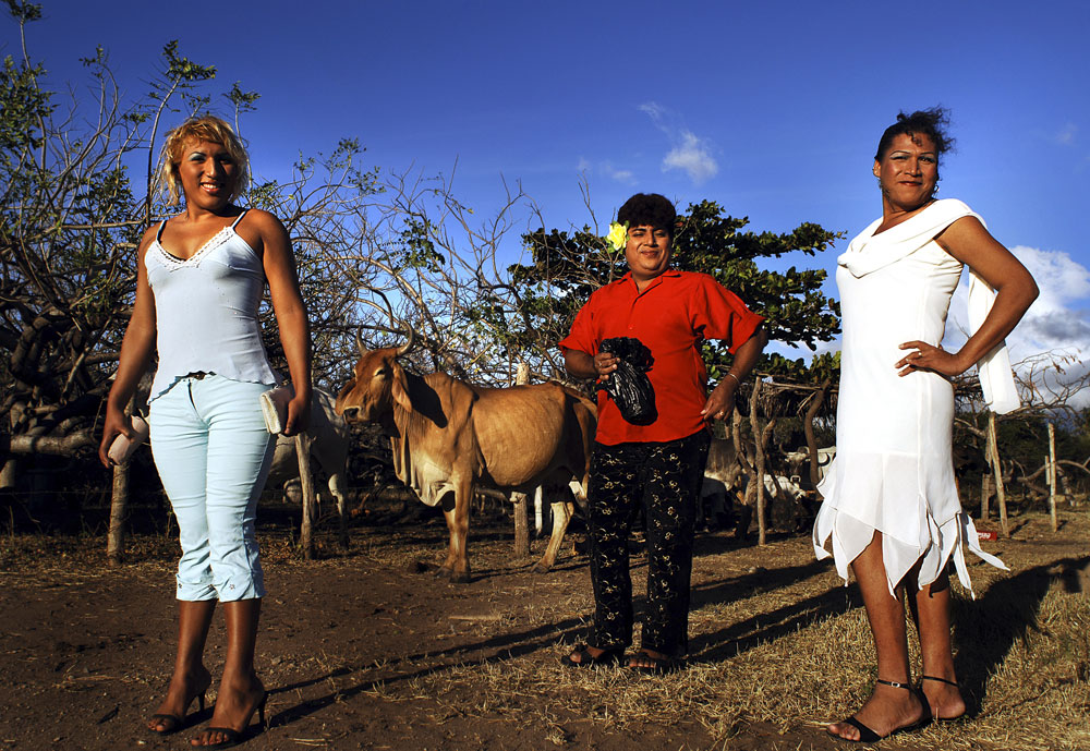 Felicza Jimenez Regalado (R), 29 years old and her Muxe friends stand in a ranch before attending a fiesta in Juchitan, Mexico