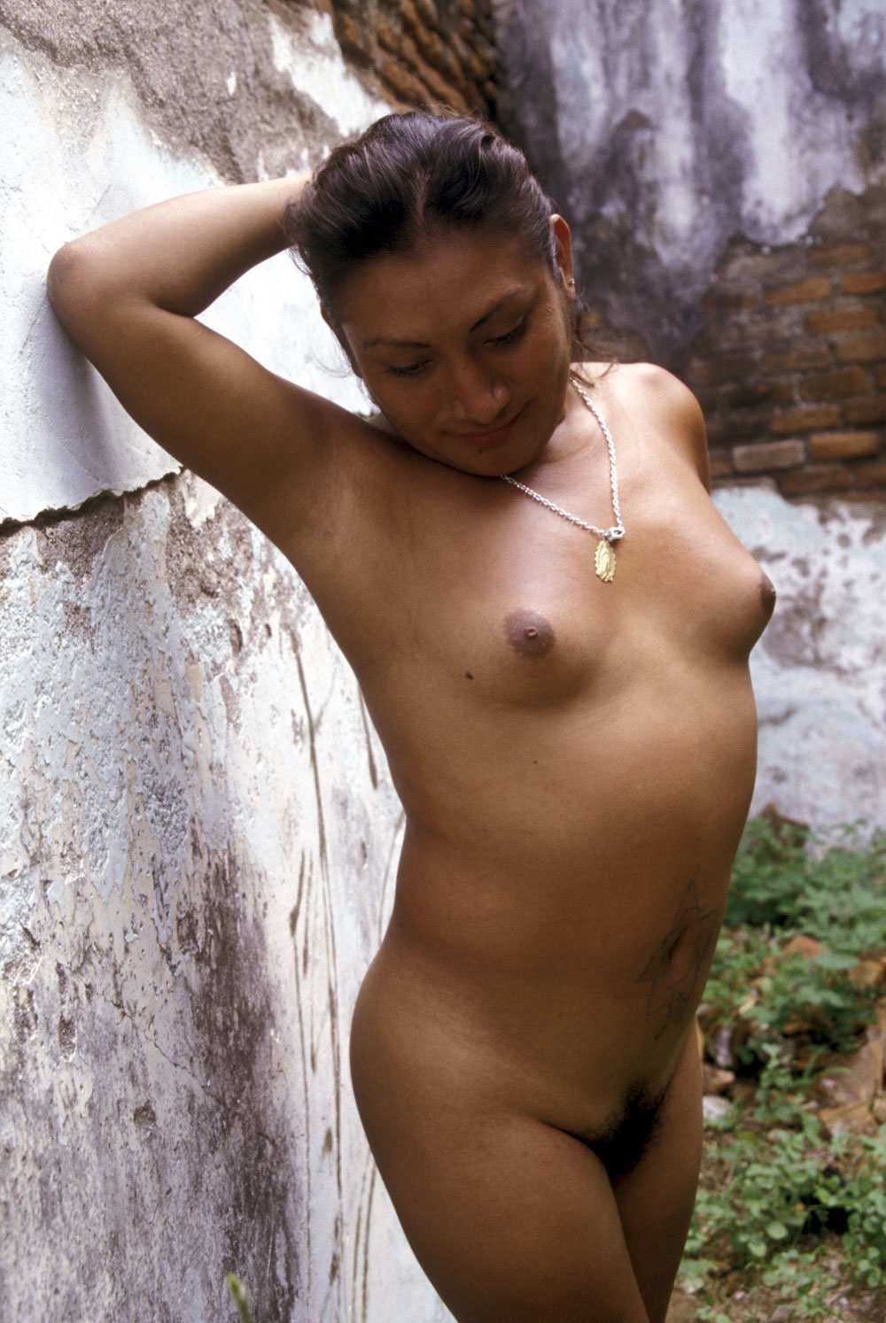 Maria Jose poses naked for a photo, as she shows of her breast that have grown do to hormone injections.