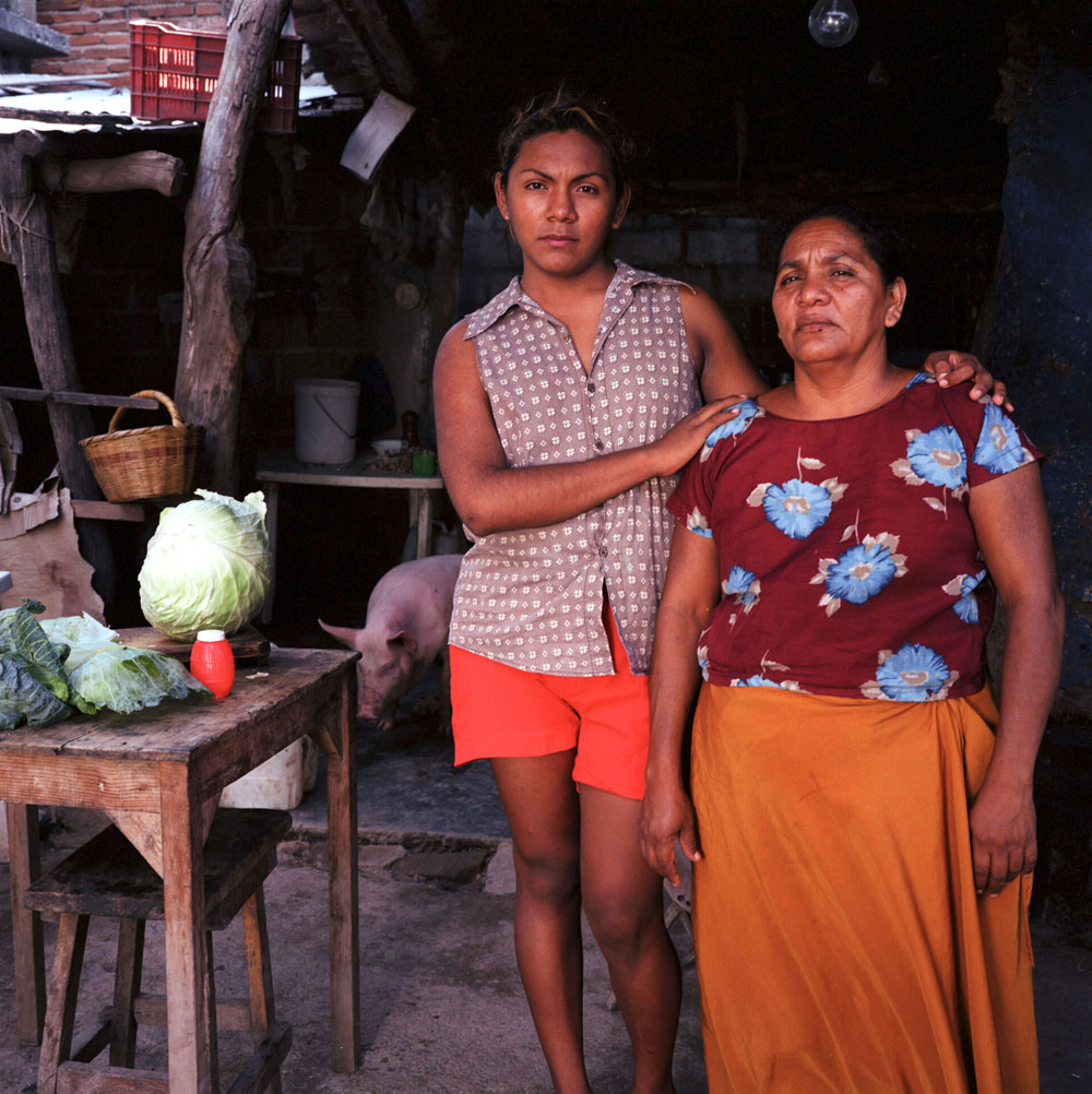 Reyna Regaldo Lopez, 47 years old, and her 17 years old son Wilbert Lopez Regalado, proudly pose for a picture in their house kitchen in Juchitan, Mexico.