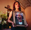 33 year old Felina Aantiago, holds a picture of her mother, Maria Cruz Vaidivleso, who died at the age of 66. When a Muxe loses her mother it's usually also to some degree and end of a social role and at time it is the Muxe that has to take over the house hold.