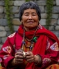 Bhutanese-Woman-Cleaning-Offerring-Cups-20121001_3752