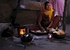 ws-indian-woman-cooking-on-fire-
