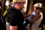 After 45 minutes of negotiations, 10 people of the extended Robinson family agree to leave their home in New Orleans. Although no water had come into their living area, street level was at least 5 feet under water. Deputy Nate Lerner, proceeds to inquire about the health of a mother's 4-month-old baby who appeared to be faring well.