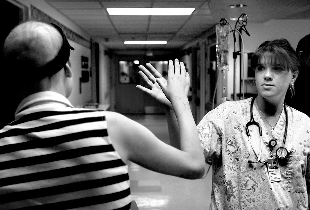 Mooda leaves the hospital getting a high-five from Michelle Jennings, one of her nurses. Mooda's wrist had swollen after having an IV put in and a pen circle was drawn to show the extent of the swelling.