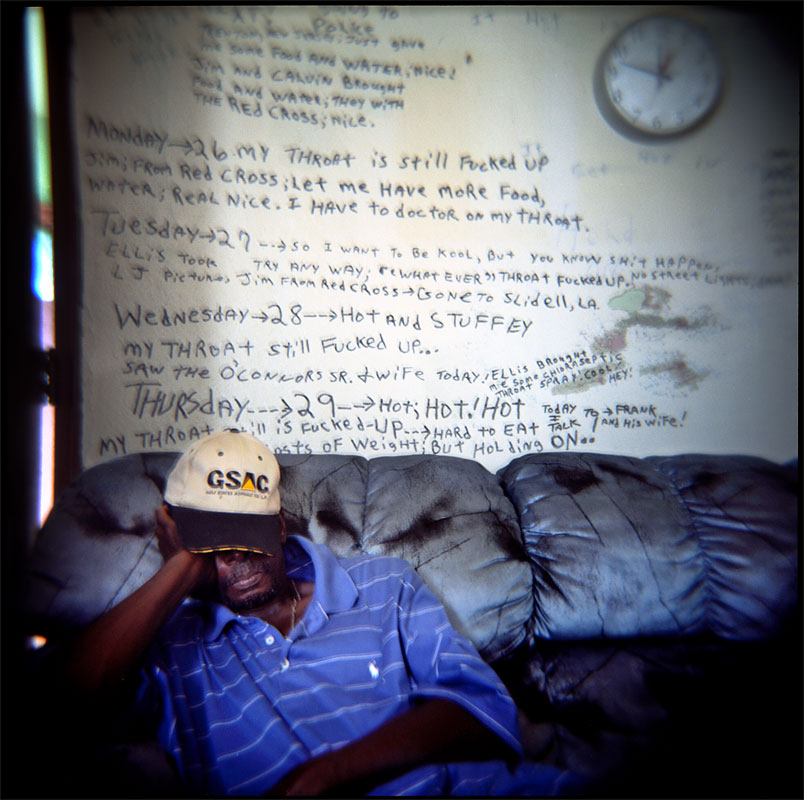 Tommie Elton Mabry rests in an apartment in the B.W. Cooper housing project along Martin Luther King Jr. Boulevard in New Orleans. Mabry remained inside the building during the flooding and kept a written log on the walls, recounting each day since Hurricane Katrina through Oct. 31. The 80 plus buildings in the projects had floodwater that reached anywhere from their foundation to several feet inside the first floor. Two months following the storm, only a handful of residents resided in the complex. The city declared it must be cleared by Dec. 31, 2005.