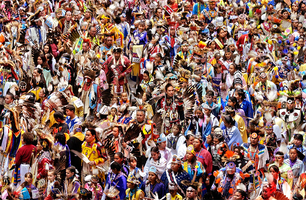 Native American dancers flood the floor of The Pit in Albuquerque during the Grand Entry of the 2004 Gathering of Nation Pow Wow.