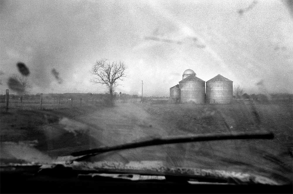 Dirt and frost obscure the view through the windshield of Bill Maronic's 1977 Toyota truck, {quote}Old Faithful.{quote} Maronic is on his way to buy wood shavings for his farm in Smiths Grove, Ky.